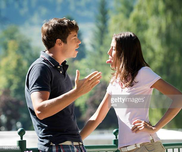 Couple Arguing, Woman sticking out Tongue, Man screaming