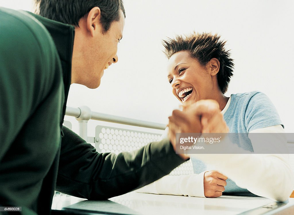 Couple Arm Wrestling Each Other : Stock Photo