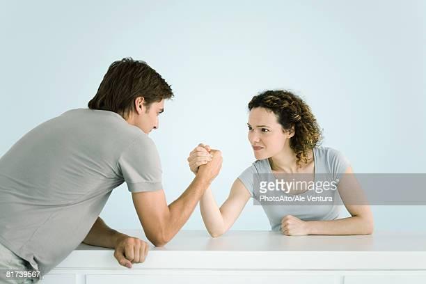 Couple arm wrestling together