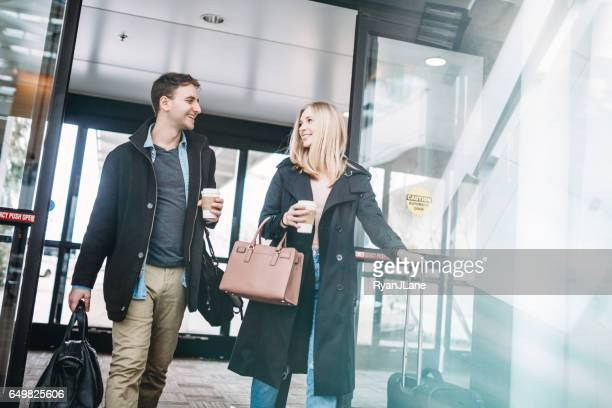 Couple Arriving at Airport Terminal
