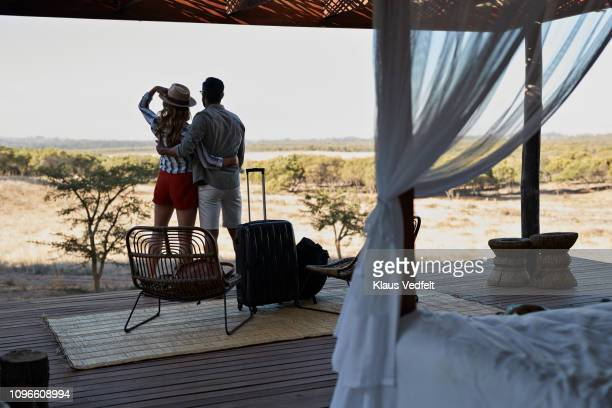 couple arriving at amazing cabin in the wild and enjoying the view - arrival stock pictures, royalty-free photos & images
