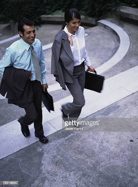 Couple ascending stairs to work