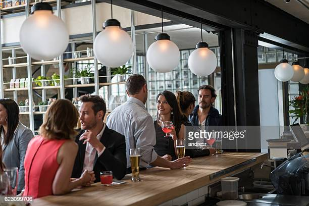 Couple at a bar having drinks after work