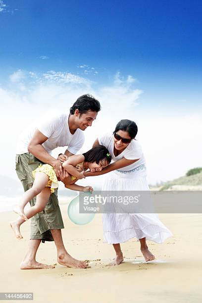 couple at a beachside with their daughter - indian subcontinent ethnicity stock pictures, royalty-free photos & images