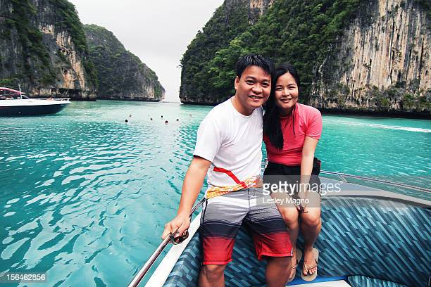 couple at a boat in a blue lagoon