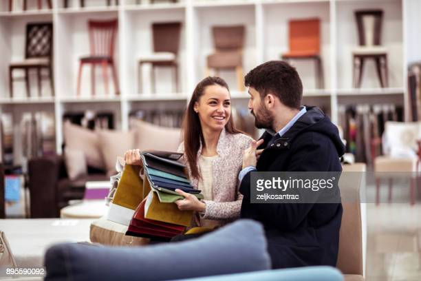 Couple at a furniture store choosing fabrics
