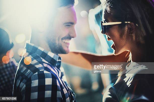 couple at a party. - nightlife stock pictures, royalty-free photos & images