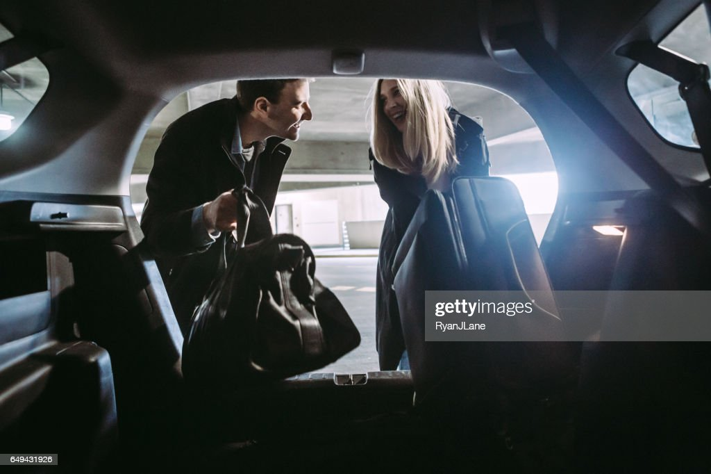 Couple at Airport Parking Garage : Stock Photo