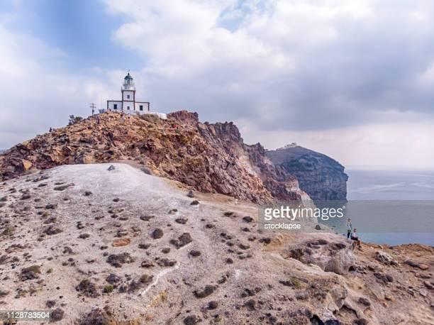 Couple at Akrotiri Lighthouse in Santorini
