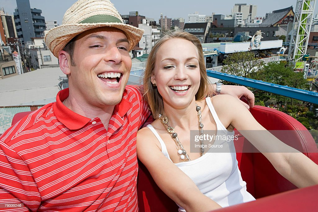 Couple at an amusement park : Stock Photo