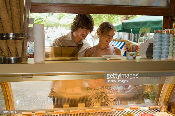 A couple at an ice cream stand