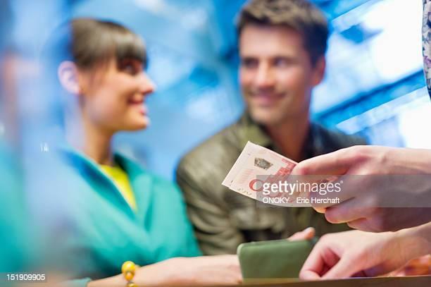 Couple at bank counter