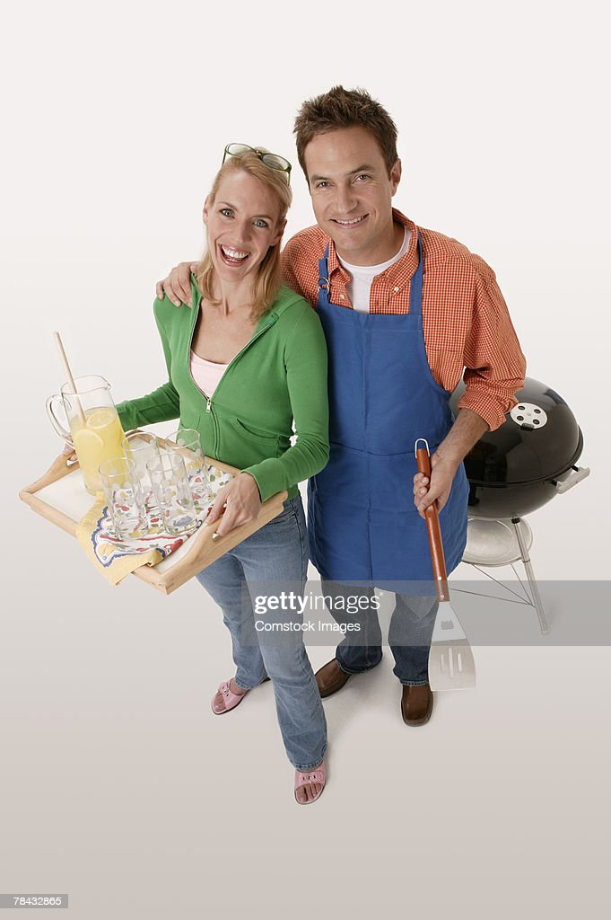 Couple at barbecue : Stockfoto