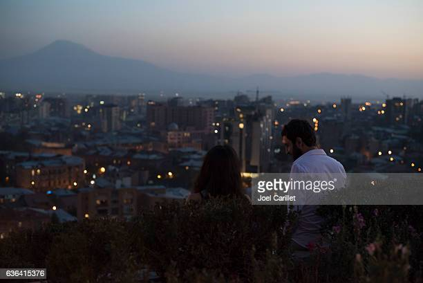 couple at cascades in yerevan, armenia at dusk - yerevan stock pictures, royalty-free photos & images