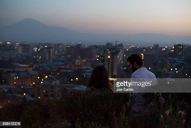 couple at cascades in yerevan, armenia at dusk - エレバン ストックフォトと画像