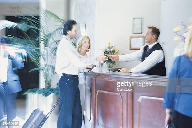 Couple at concierge's desk