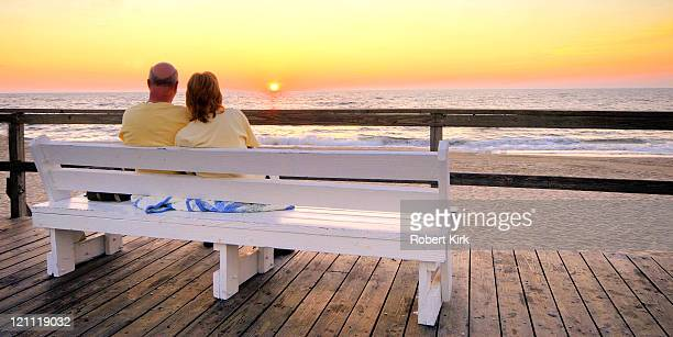 couple at dawn - bethany beach, delaware - bethany beach stock photos and pictures