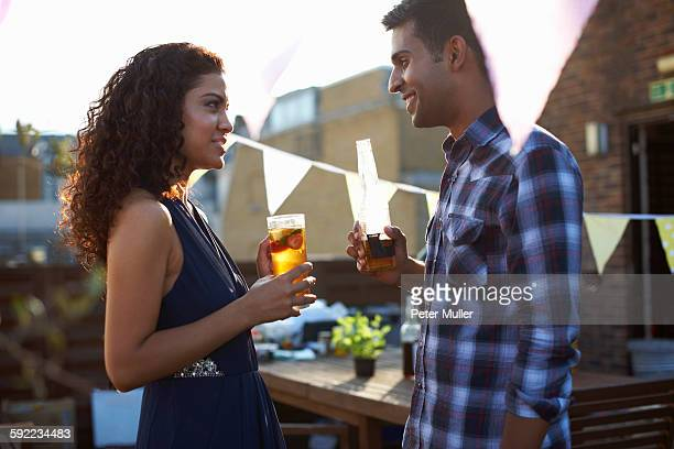 Couple at early evening party