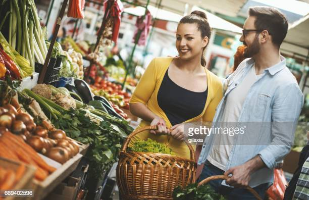 Couple at food market.