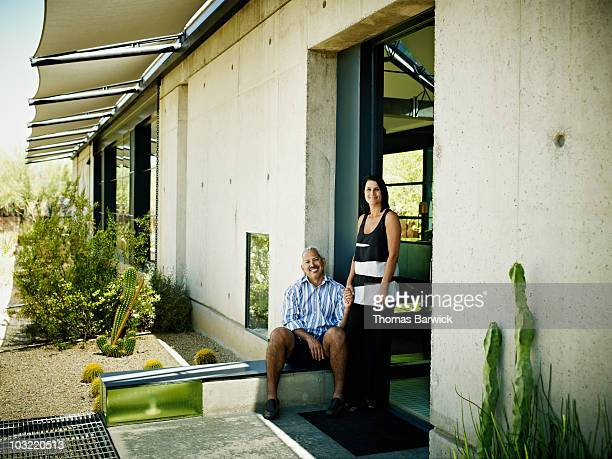 Couple at front door of contemporary home