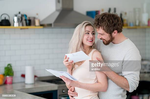 Couple at home checking the mail