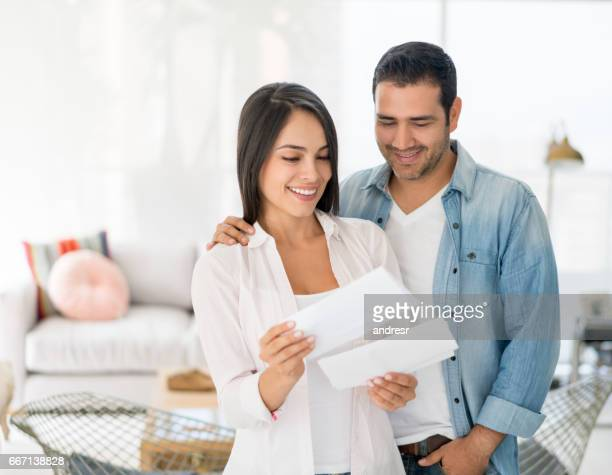 Couple at home checking their mail