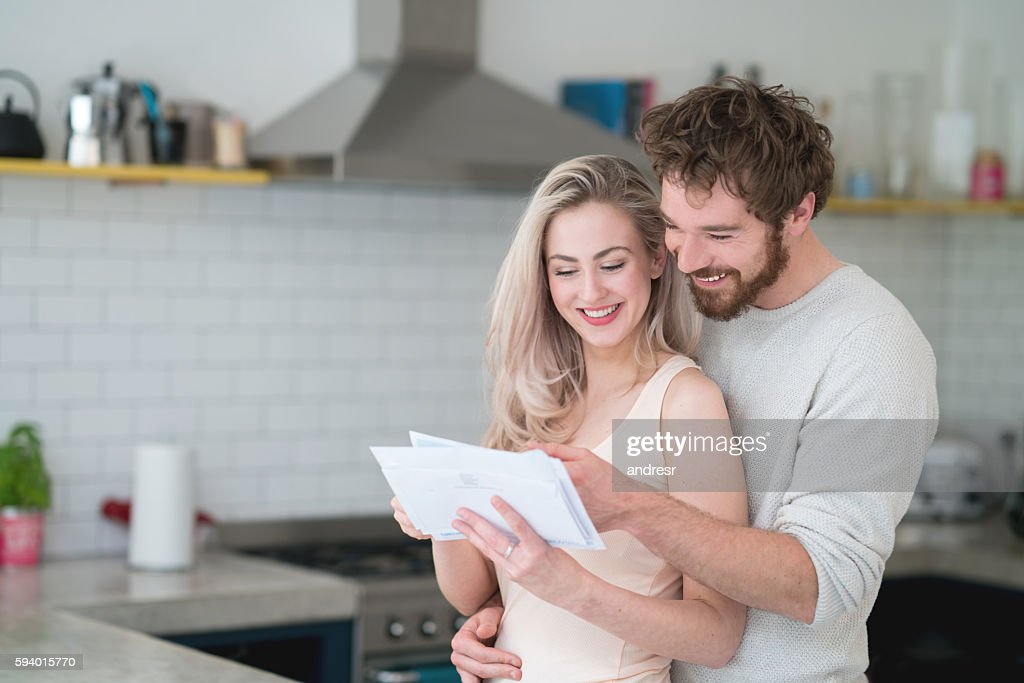 Couple at home getting the mail : Stock Photo