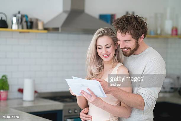 Couple at home getting the mail
