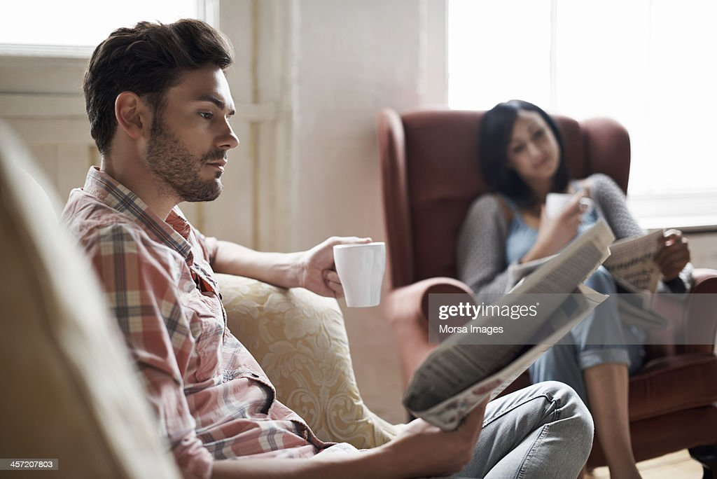 Couple at home reading : Stock Photo