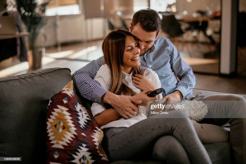 Couple at home watching TV : Stock Photo
