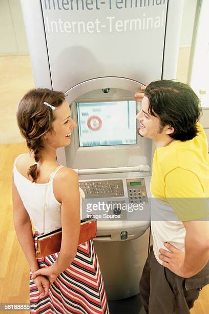 Couple at Internet terminal