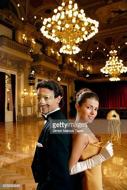 couple at masked ball - ボールルーム ストックフォトと画像