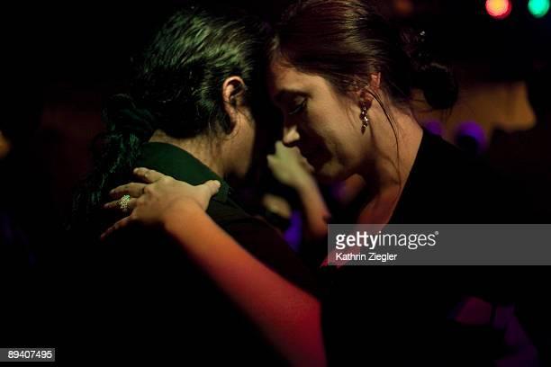 couple at milonga, dancing tango