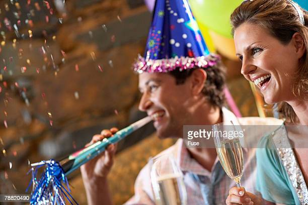 couple at new years party - 30 39 years stock-fotos und bilder
