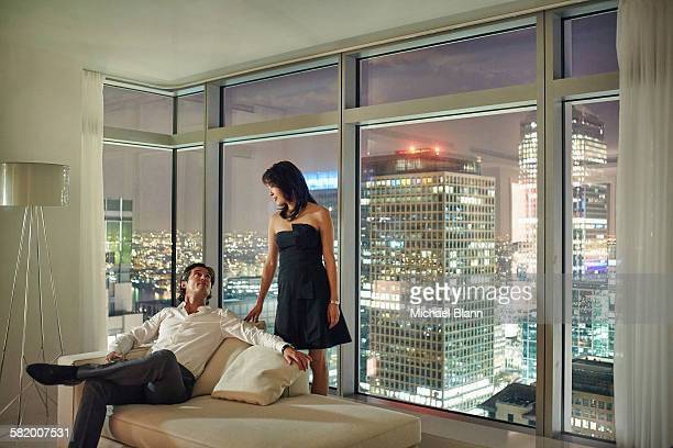 couple at night in city apartment