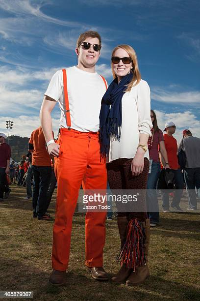 couple at outdoor event wearing team pride outfit - jason todd stock photos and pictures