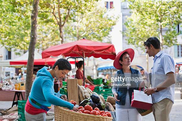 couple at outdoor market - guy carcassonne stock pictures, royalty-free photos & images