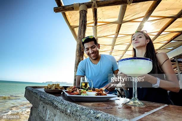 couple at outdoor restaurant - margarita beach stock photos and pictures
