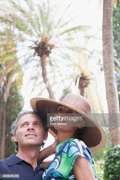 Couple at outdoors looking up