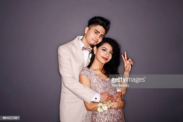 couple at prom, giving peace sign. - prom stock pictures, royalty-free photos & images