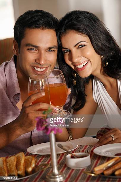 couple at restaurant, raising for a toast