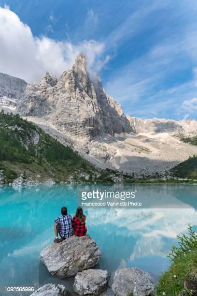 couple at sorapis lake, dolomites. - belluno stock pictures, royalty-free photos & images