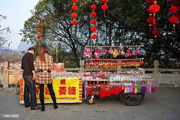 Couple at souvenir stall on Binjiang Lu.