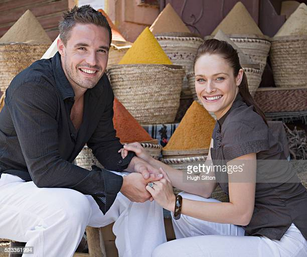 couple at spice market - hugh sitton stock pictures, royalty-free photos & images