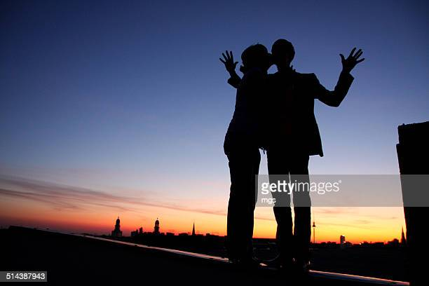 couple at sunset - friedrichshain stock photos and pictures