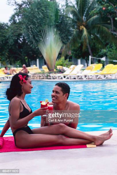 Couple At Swimming Pool with Drinks