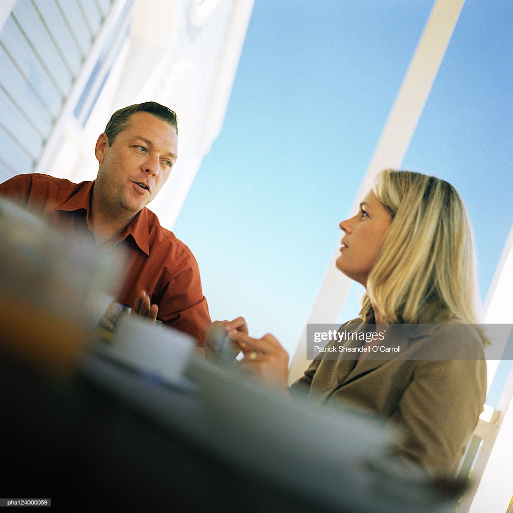 Couple at table, low angle view : Stockfoto
