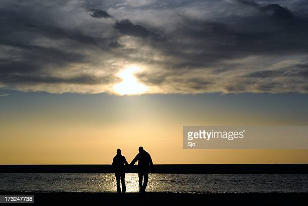 """couple at the beach - """"sjoerd van der wal"""" or """"sjo"""" stock pictures, royalty-free photos & images"""