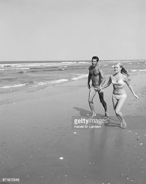couple at the beach - number of people stock pictures, royalty-free photos & images