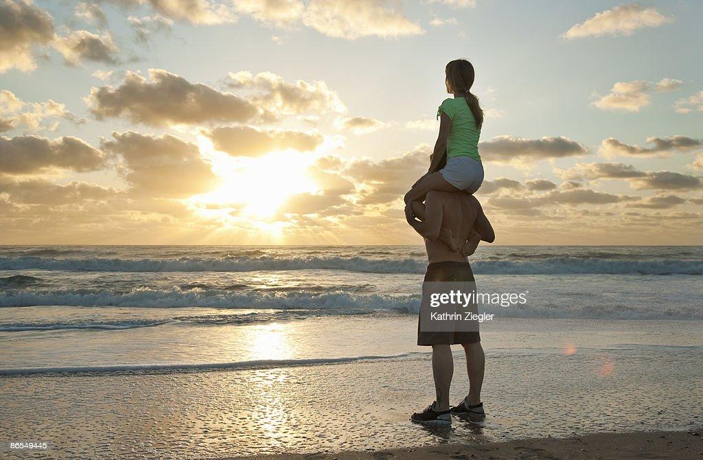 Couple at the beach, sunrise : Stock Photo